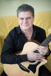 Two time oscar winning composer Gustavo Santaolalla with his guitar. Toronto, ON. February 4, 2014. Nick Kozak/For the Toronto Star.